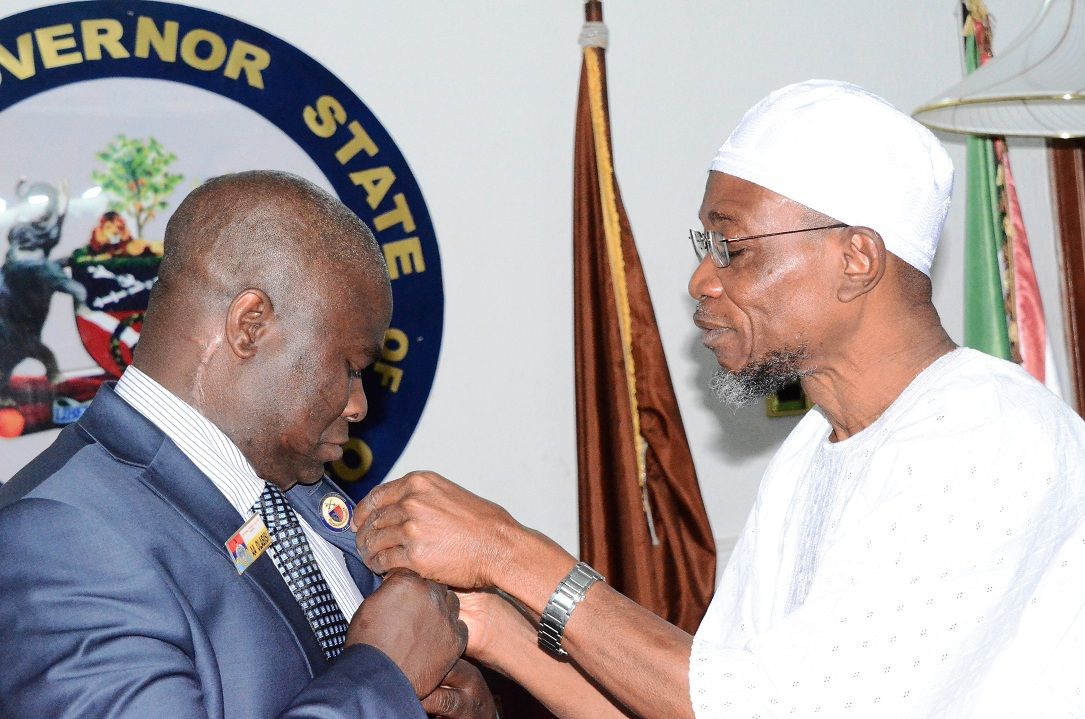 Governor State of Osun, Ogbeni Rauf Aregbesola and Director National Military Strategy of the National Defence College, Course 23, Commodore Abdul Ganiy Olabisi, during a Team from Defence College's visit to the Governor at Government House, Osogbo, the State of Osun on Tuesday 02-12-2014