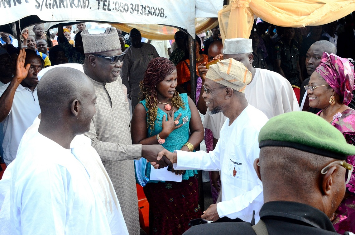From Right, Governor State of Osun, Ogbeni Rauf Aregbesola; Secretary, Osun National/State Assembly Primaries Committee, Mustapha Maoshood; Deputy Governor, Mrs Titi Laoye-Tomori ((right) and a member, Sada Machika (left), during primaries/declaration of the party's flagbearers to the National/State Assemblies at Nelson Mandela Freedom Park, Osogbo, State of Osun on Tuesday 09-12-2014