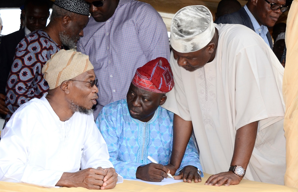 From left, Governor State of Osun, Ogbeni Rauf Aregbesola; Secretary, All Progressives Congress (APC), Osun Chapter, Rasaq Salensile and Osun APC Chairman, prince Gboyega Famodun, during primaries/declaration of the party's flagbearers to the National/State Assemblies, at Nelson Mandela freedom Park, Osogbo, State of Osun on Tuesday 09-12-2014