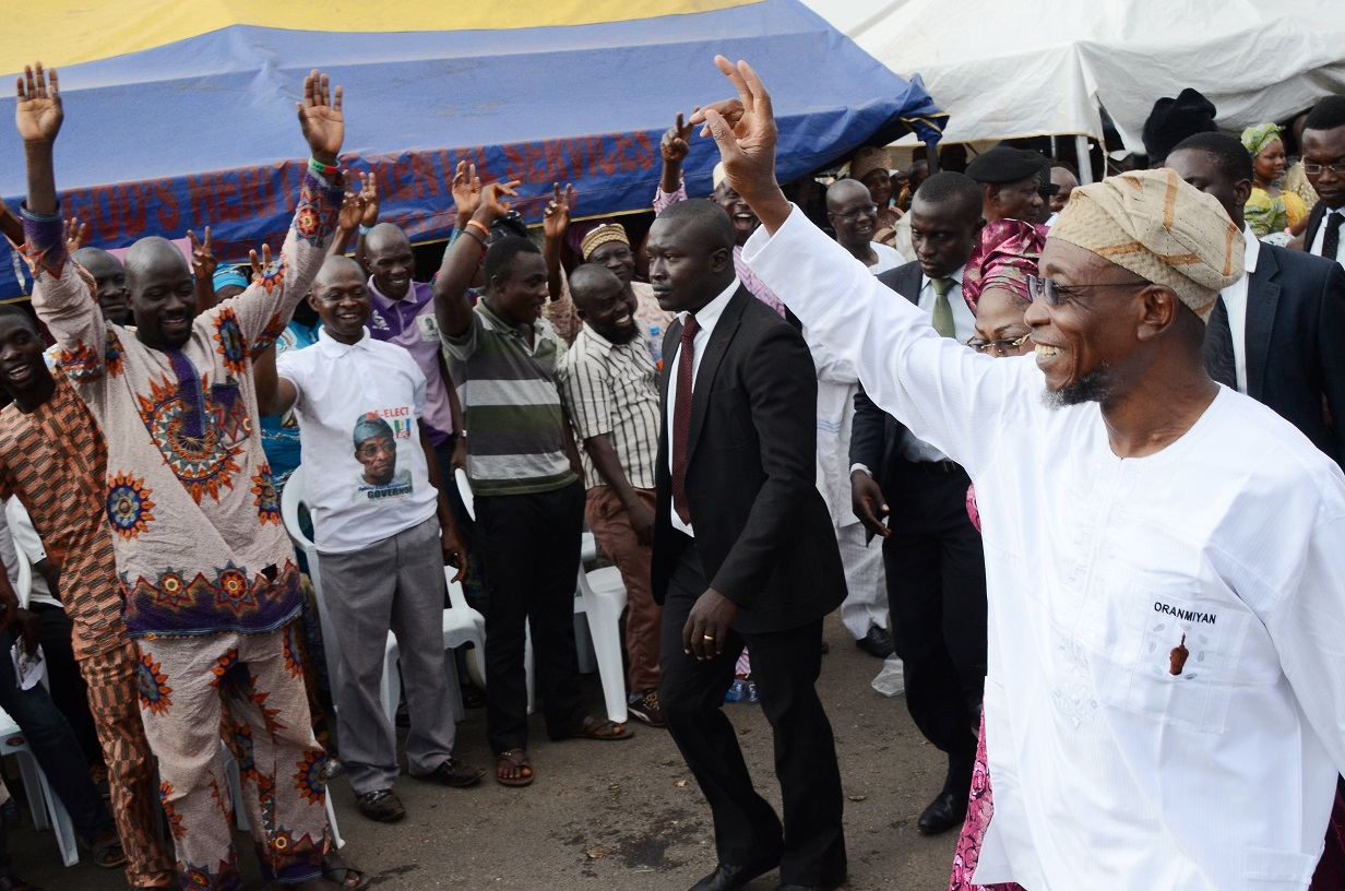 Governor State of Osun, Ogbeni Rauf Aregbesola (right) acknowledging cheers from his party members,during declaration of the party's flagbearers to the National/State Assemblies, at Nelson Mandela Freedom Park, Osogbo, State of Osun on Tuesday 09-12-2014