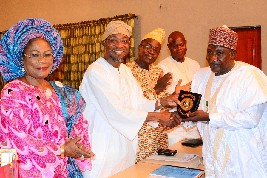 Governor State of Osun, Ogbeni Rauf Aregbesola (2nd left) presenting a Plague to National President, Nigerian Association of Auctioneers (NAA), Alhaji Aliyu Kiliya (right); Deputy Governor, Mrs Titi Laoye-Tomori (left); Head of Service, Mr Olayinka Owoeye (3rd left) and Former Commissioner for Regional Integration and Special Duties, Barrister Ajibola Basiru, during the Governor's investiture as NAA Patron at Government House, Osogbo, State of Osun on Sunday 14-12-2014