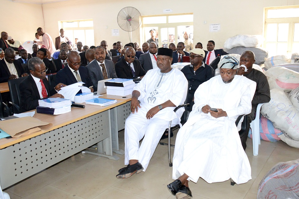 Cross Section of Governor Aregbesola's lawyers from left, Vice Pesidential Candidate of APC, Prof. Yemi Osinbajo, Mr Bashiru Ajibola, Mr. Ibrahim Lawal and others. With them are Govrrmor Rauf Aregbesola of Osun (right) and APC Party Chairman, Prince Gboyega Famodun, at the the sitting of Election Petition Tribunal at the State High Court, Osogbo on Friday 19-12-2014