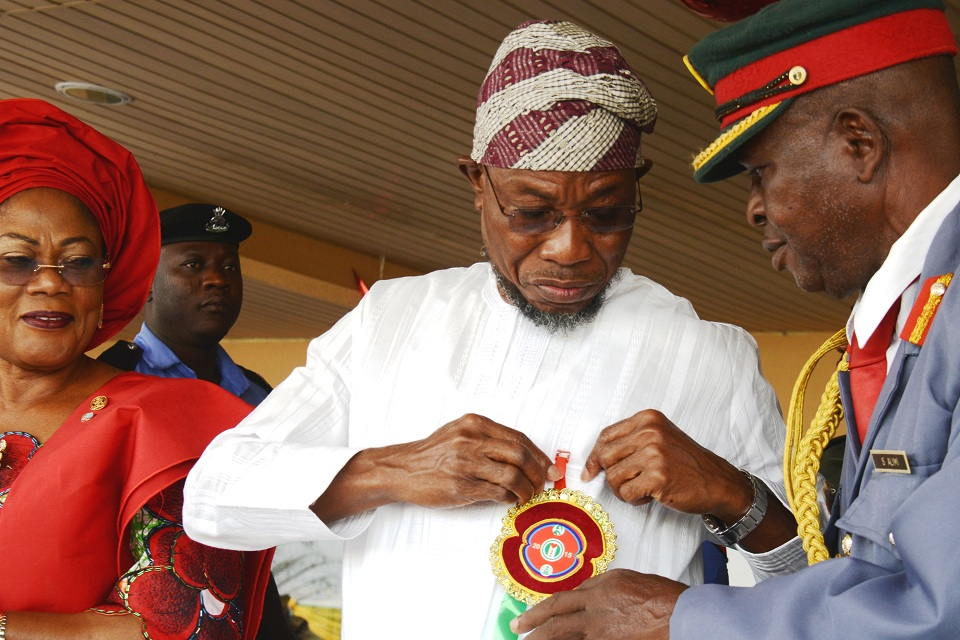 From right, Chairman of Legion, Col. Alimi Samotu, Governor State of Osun, Ogbeni Rauf Aregbesola and Deputy Governor, Mrs. Titi Laoye-Tomori,during the Launching of 2015 Emblem of the Armed Forces Remembrance Day Celebration at Government House Osogbo, State of Osun, on Tuesday 6/01/2015.