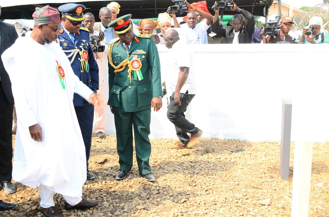 From Left, Governor State of Osun, Ogbeni Rauf Aregbesola; Commandant, Nigerian Air Force Institute of Safety, Ipetu-Ijesa, Air Commodore Oyewole Jackson and Commander, Engineer Construction Company, (ECC) Ede, Brigadier General Gbenga Adeyemi inspecting the Fallen Heroes Military Tomb, during 2015 Armed forces Remembrance Day Celebration in Osogbo, State of Osun on Thursday 15-01-2015