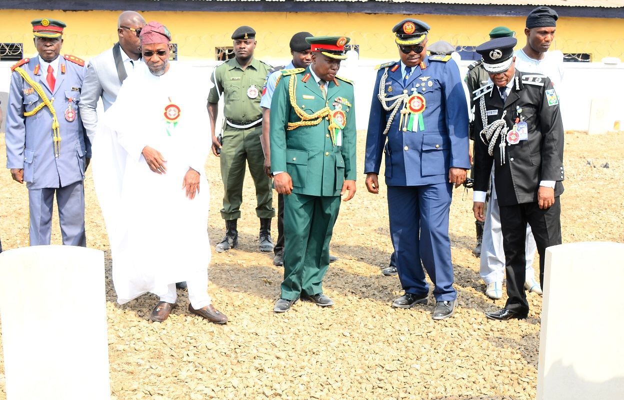 Governor State of Osun, Ogbeni Rauf Aregbesola (2nd left); Commandant, Nigerian Air Force Institute of Safety, Ipetu-Ijesa, Air Commodore Oyewole Jackson (2nd right); Commander, Engineer Construction Company, (ECC) Ede, Brigadier General Gbenga Adeyemi (3rd right); Chairman Nigerian Legion, State of Osun, Colonel Alimi Samotu (left); Commissioner of Police, Osun Command, Abubakar Marafa (right) and others, inspecting the Fallen Heroes Military Tomb, during 2015 Armed forces Remembrance Day Celebration in Osogbo, State of Osun on Thursday 15-01-2015