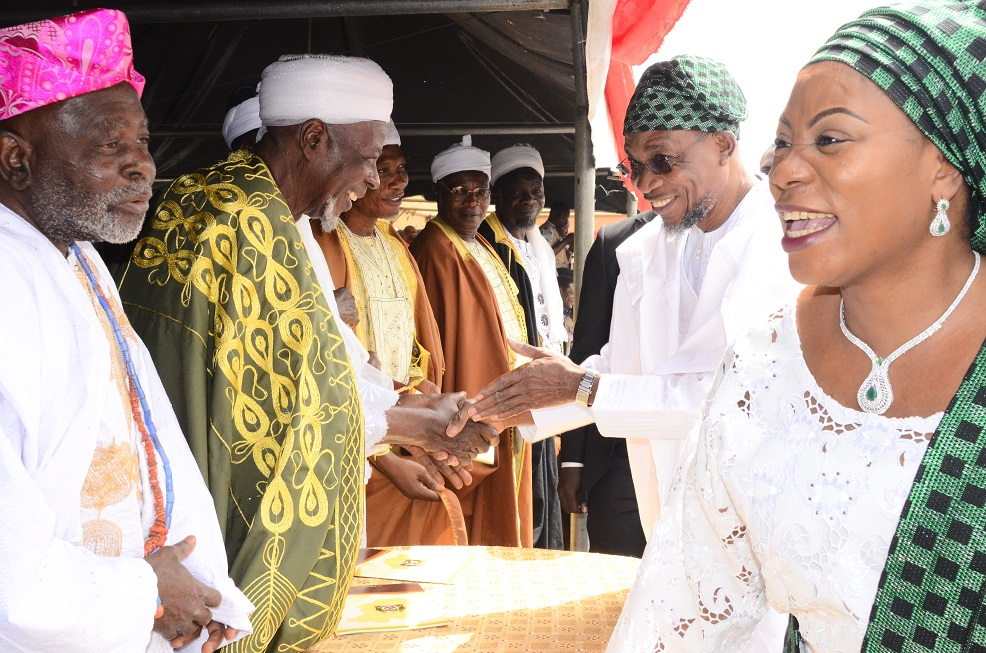 Governor of the State of Osun, Ogbeni Rauf Aregbesola (2nd right), his wife, Mrs. Sherifat Aregbesola (right) exchanging pleasantries with Chief Imam of Osogboland, Sheikh Musa Animasahun (2nd left);  Araba Awo of Osogboland, Chief Ifayemi Elebuibon (left) and others, during the Inter-religious Service for the New Year 2015 at office of the Governor, State Secretariat, Osogbo on Monday 05/01/2015.