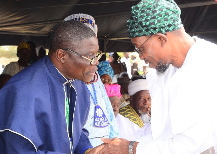 Governor of the State of Osun, Ogbeni Rauf Aregbesola exchanging pleasantries with Chairman, Christian Association of Nigeria (CAN), Reverend Elisah Ogundiya during the Inter-religious Service for the New Year 2015 at Office of the Governor, State Secretariat, Osogbo on Monday 05/01/2015.