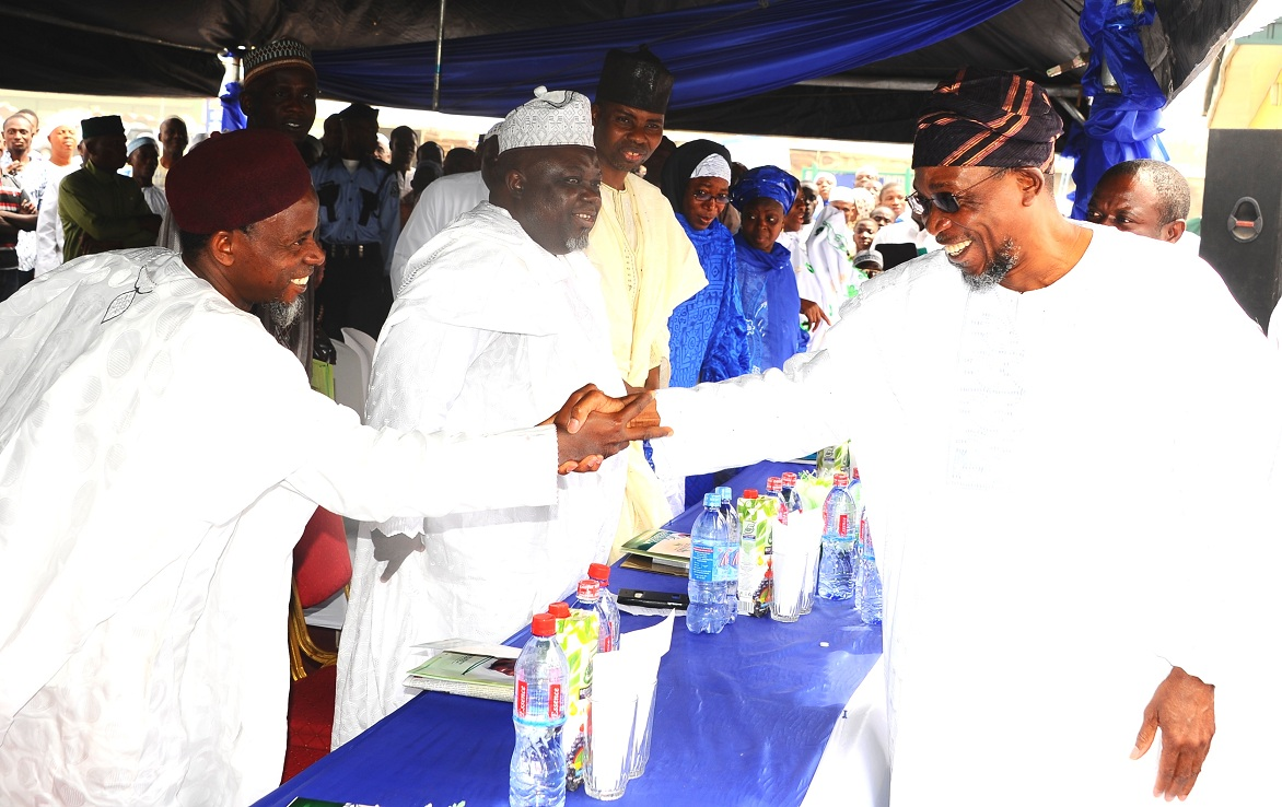 Governor State of Osun, Ogbeni Rauf Aregbesola, exchanging pleasantries with Deputy Chief Missioner, Nasrul-Lahi-Fatih Society of Nigeria (NASFAT), Imam Onike Abdul-Azeez.  With them is Chief Missioner, Abdulahi Akinbode; Guest Lecturer, Prof. Hafis Oladosu and others, during NASFAT Special Thanksgiving Service on Osun Governor's victory, at Mandela Freedom Park, Osogbo on Sunday 11-01-2015