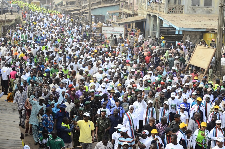 All Progressives Congress (APC) Vice Presidential Candidate, Professor Yemi Osinbajo; Governor State of Osun, Ogbeni Rauf Aregbesola (waving hands in the front row), leading a Mammoth Crowd, during a Walk For Change exercise to mobilize support for Buhari/Osinbajo Presidency in Osogbo, State of Osun on Wednesday 07-01-2015