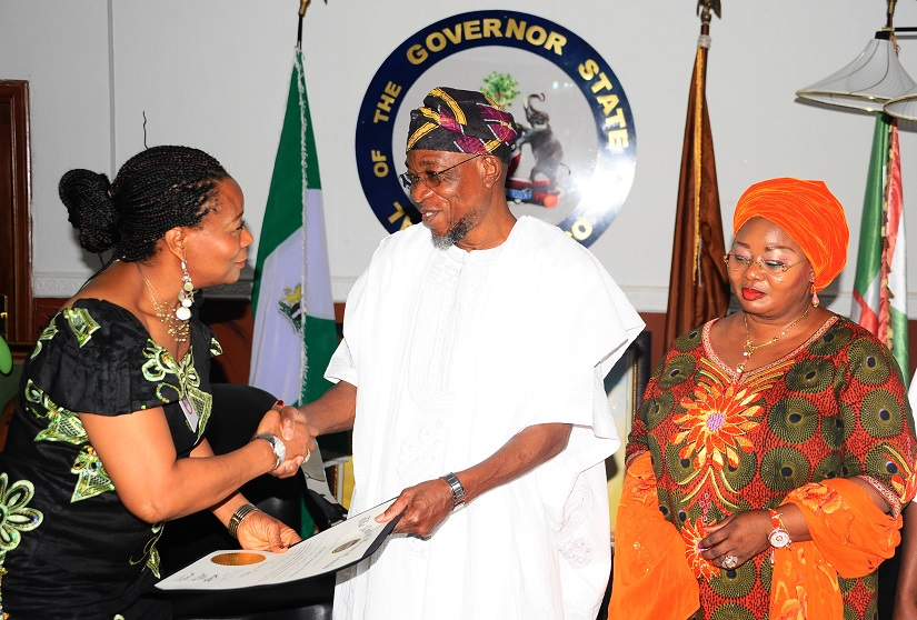 Presenter, All Eyes on Africa TV Show, Kemi Fadojutimi (left) presenting a Congratulatory Letter to Governor State of Osun, Ogbeni Rauf Aregbesola (middle) on behalf of Martin O'Malley the Governor, State of Maryland, United States of America, at Government House, Osogbo recently With them is, Former Special Adviser to the governor on Federal Matters, Idiat Babalola (right).
