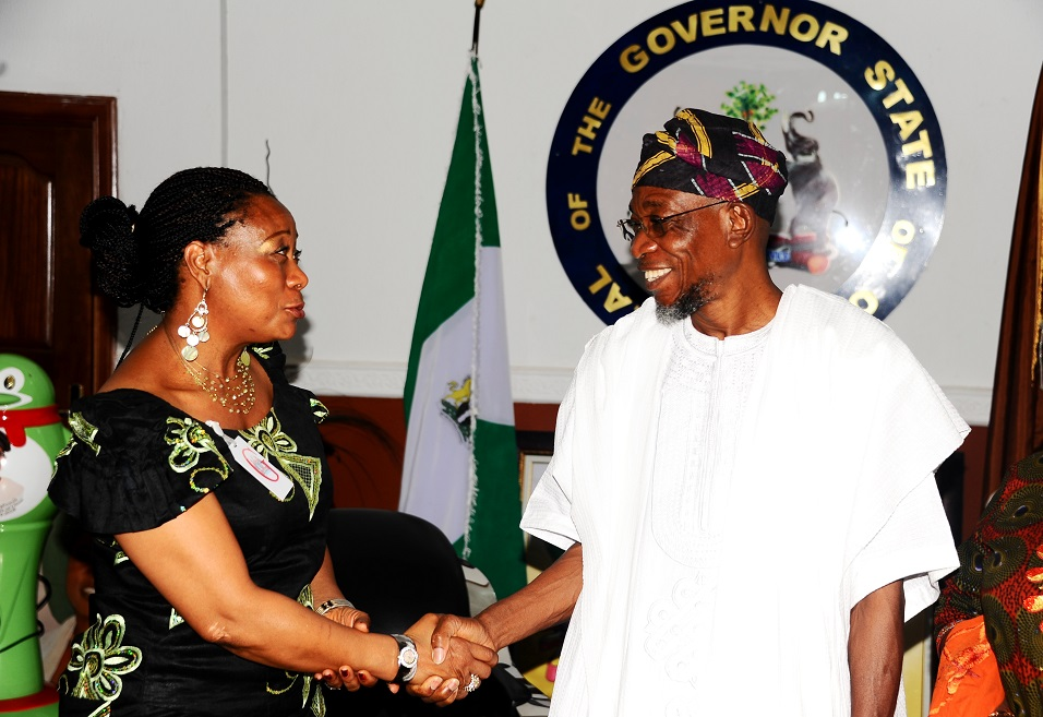 Presenter, All Eyes on Africa TV Show, Kemi Fadojutimi (left) with Governor State of Osun, Ogbeni Rauf Aregbesola, during a Courtesy Visit to the Governor on behalf of Martin O'Malley the Governor, State of Maryland, United States of America, at Government House, Osogbo recently