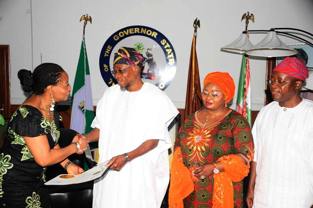 Presenter, All Eyes on Africa TV Show, Kemi Fadojutimi (left) presenting a Congratulatory Letter to Governor State of Osun, Ogbeni Rauf Aregbesola (middle) on behalf of Martin O'Malley the Governor, State of Maryland, United States of America, at Government House, Osogbo on recently. With them are, Former Chief of Staff, Alhaji Gboyega Oyetola (right) and Former Special Adviser on Federal Matters, Idiat Babalola (2nd right).