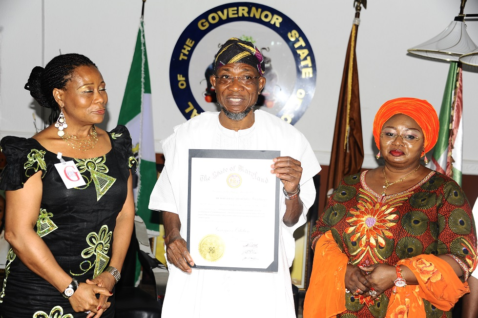 From left, Presenter, All Eyes on Africa TV Show, Kemi Fadojutimi; Governor State of Osun, Ogbeni Rauf Aregbesola and Former Special Adviser on Federal Matters, Idiat Babalola, during a Courtesy Visit on behalf of Martin O'Malley, Governor State of Maryland, United States of America, at Government House, Osogbo recently