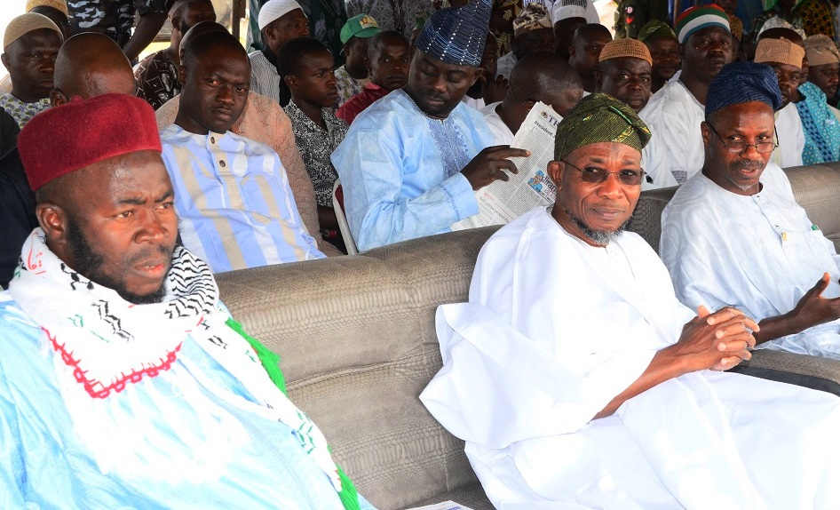 Governor of the State of Osun, Ogbeni Rauf Aregbesola (middle); National President Jama'atu Ta'awunil Muslimeen, Sheikh Daood Imran Molasan (left) and Former Assistant Chief of Staff to the Governor State of Osun, Mr.Mudasiru Toogun (right) during the 16th Annual National  Conference of Jama'atu Ta'awunil Muslimeen at District Council Elementary School, Araromi, lwo, State of Osun on recently
