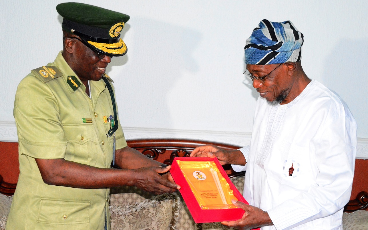 Governor State of Osun, Ogbeni Rauf Aregbesola (right) with Assistant Controller General of Prisons (ACG) Zonal Coordinator, Zone 'F', Ibadan, Mr Emmanuel Ogundele, during a Courtesy call on the Governor at Government house, Osogbo, State of Osun on Thursday 12-02-2015