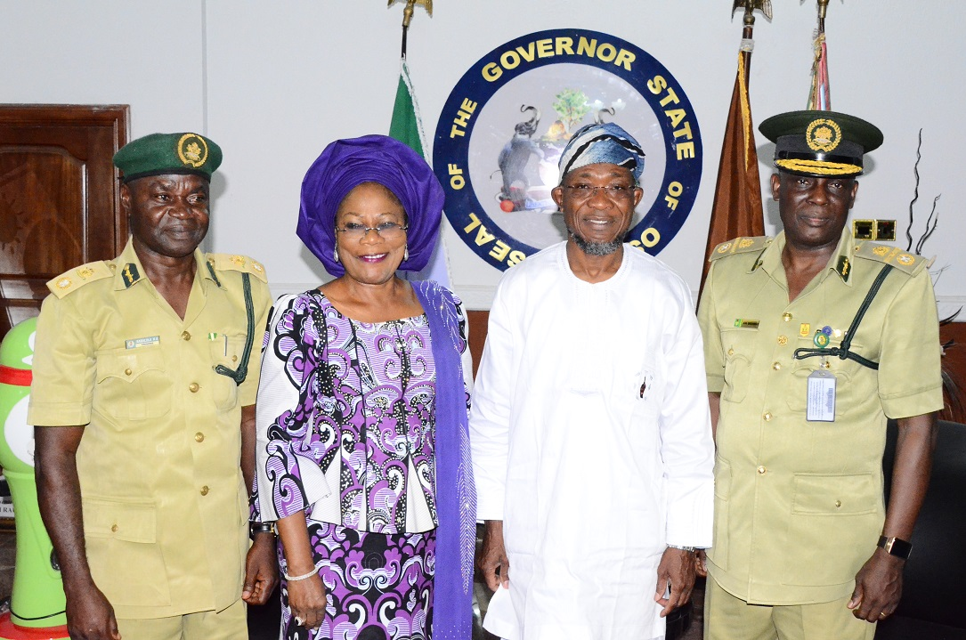 Governor State of Osun, Ogbeni Rauf Aregbesola (2nd right); his Deputy, Mrs Titi Laoye-Tomori (2nd left); Assistant Controller General of Prisons (ACG) Zonal Coordinator, Zone 'F', Ibadan, Mr Emmanuel Ogundele (right) and Controller of Prisons, Osun Command, Deacon Babalola Kunle (left), during a Courtesy call on the Governor at Government house, Osogbo, State of Osun on Thursday 12-02-2015