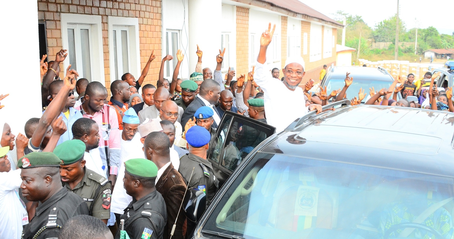 Governor State of Osun, Ogbeni Rauf Aregbesola acknowledging cheers from the people during an Inspection Tour to the A.U.D Elementary School, Inisha, at the weekend