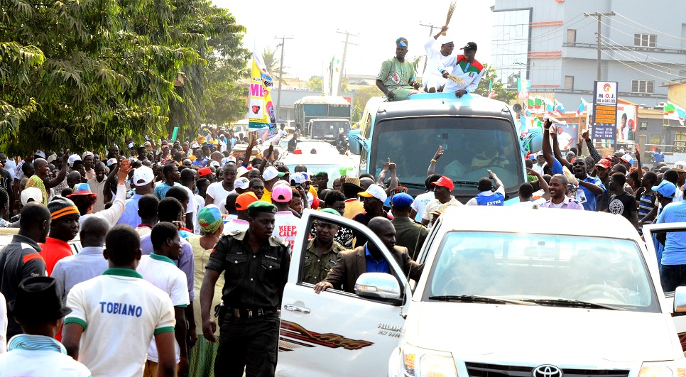 Governor State of Osun, Ogbeni Rauf Aregbeola [middle], lagos State Organizing Secretary All   Progressive Congress [APC], Alhaji Abdullahi Enilolobo [left],and Lagos State House of Assemble Member Alimosho Constituency, Hon. Prince Bisi Yusuff [right] on the top of a vehicle acknowledging cheers from supporters, during APC Governorship Candidate Mega Rally, Akinwunmi Ambode at Alimosho Local Government Lagos State on Monday