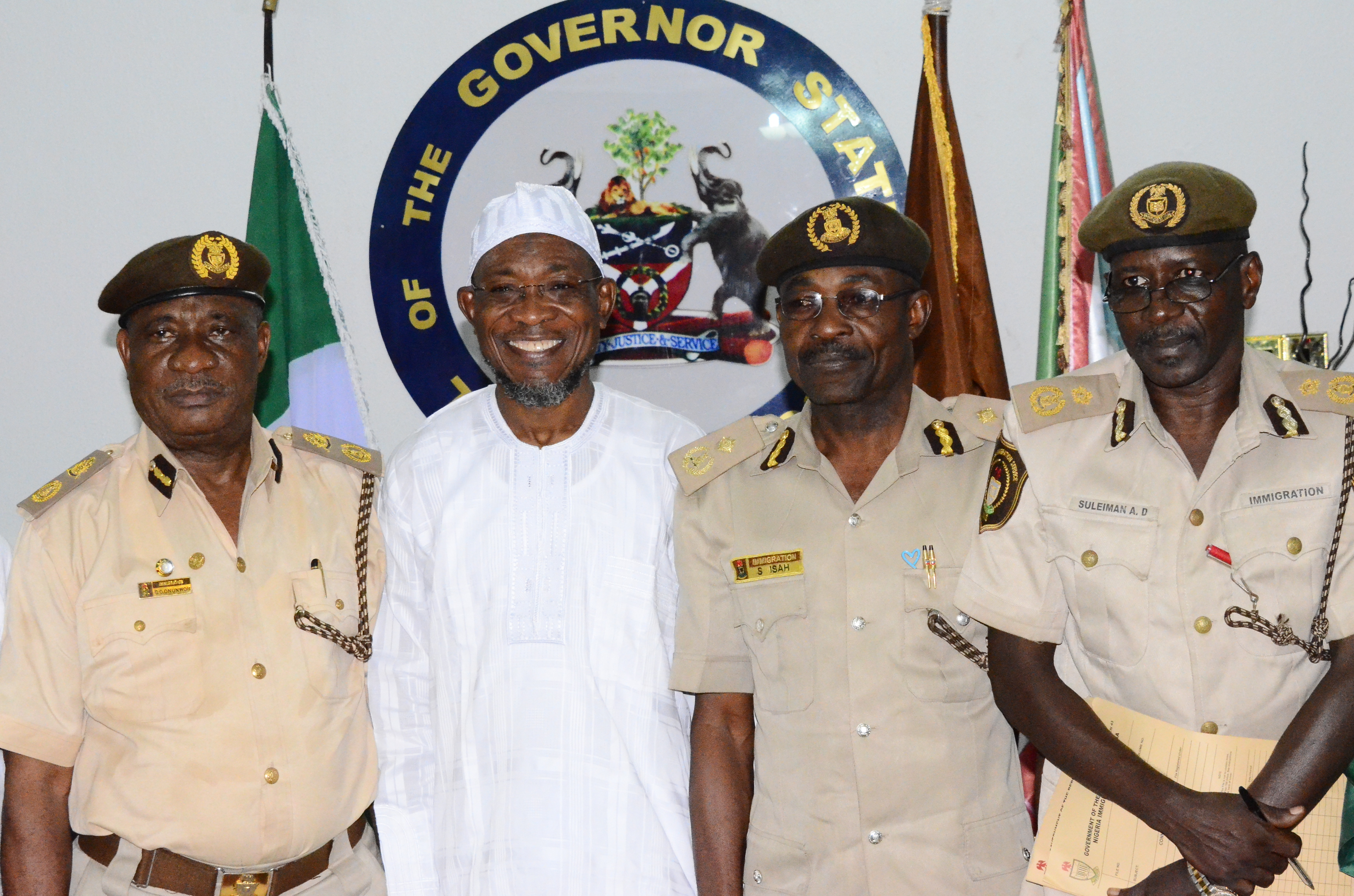 Governor State of Osun, Ogbeni Rauf Aregbesola (2nd left); Osun State Comptroller of Immigration, Mr. Onunwor Chris (left); Passport Control Officer of Immigration, Mr. Isah Salihu (2nd right); Deputy Comptroller of Immigration,  Mr. Aminu Suliman (right), during a Courtesy Visit to the Governor, at Government House, Osogbo on Thursday 19/02/2015.