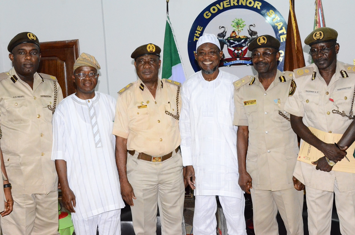 Governor State of Osun, Ogbeni Rauf Aregbesola (3rd right); Osun State Comptroller of Immigration, Mr. Onunwor Chris (3rd left); Chief of Staff to the Governor, Alhaji Gboyega Oyetola (2nd left); Assistant Comptroller Economic Community of West African States (ECOWAS) and African Affairs, Mr. Ndupu Udoamaka (left); Passport Control Officer of Immigration, Mr. Isah Salihu (2nd right); Deputy Comptroller of Immigration,  Mr. Aminu Suliman (right) during a Courtesy Visit to the Governor at Government House, Osogbo on Thursday 19/02/2015.