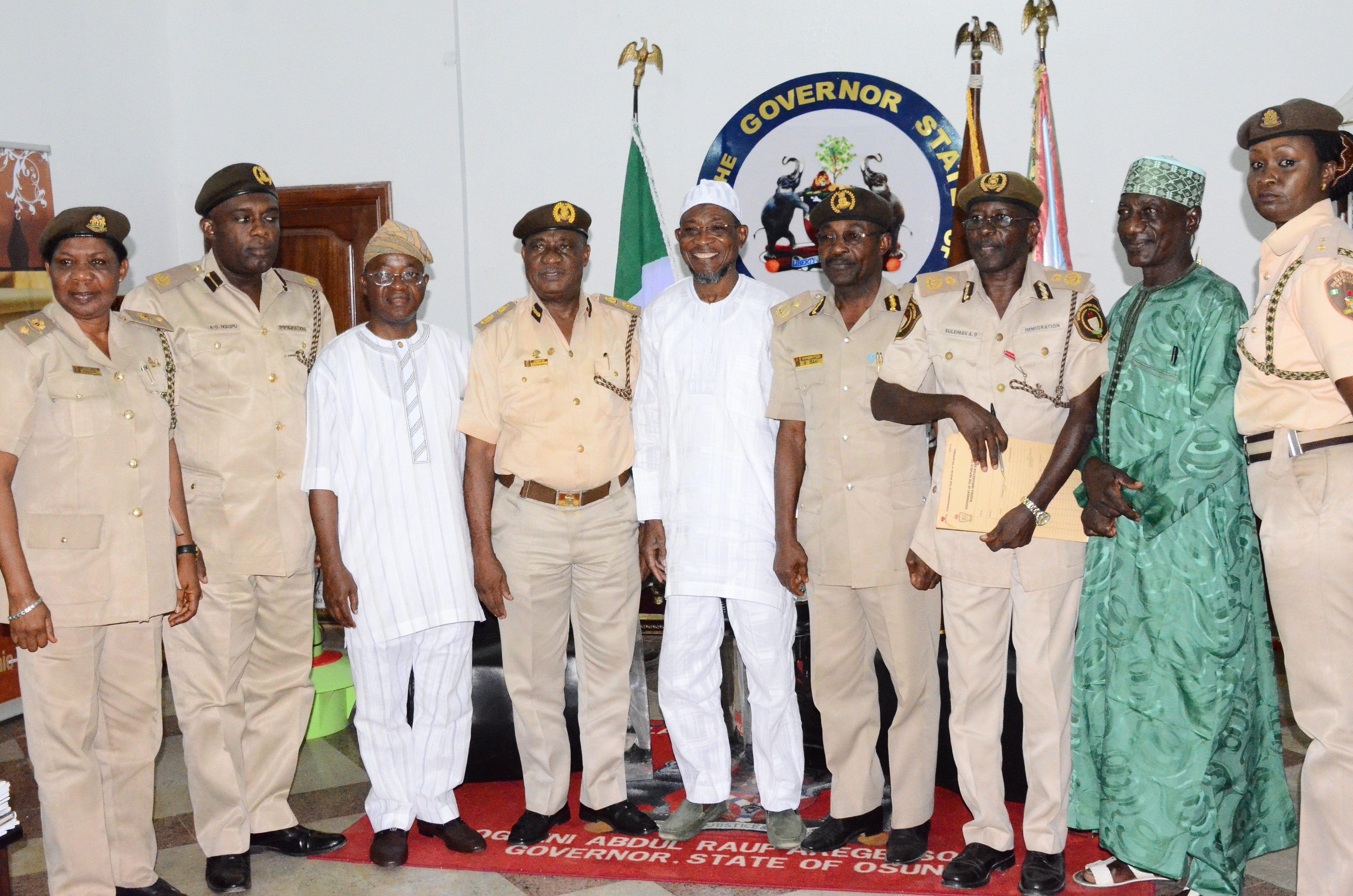 Governor State of Osun, Ogbeni Rauf Aregbesola (middle); Osun State Comptroller of Immigration, Mr. Onunwor Chris (4th left); Chief of Staff to the Governor, Alhaji Gboyega Oyetola (3rd left); Assistant Comptroller Economic Community of West African States (ECOWAS) and African Affairs, Mr. Ndupu Udoamaka (2nd left); Chief Superintendent of  Immigration, Mrs. Funmi Bewaji (left); Passport Control Officer of Immigration, Mr. Isah Salihu (4th right);  Deputy Comptroller of Immigration,  Mr. Aminu Suliman (3rd right); Assistant Comptroller of Investigation of Immigration, Mr. Shehu Usman Adamu (2nd right) and Public Relations Officer (PRO), Mrs. Inibokun Famiyide during a Courtesy Visit to the Governor at Government House, Osogbo on Thursday 19/02/2015.