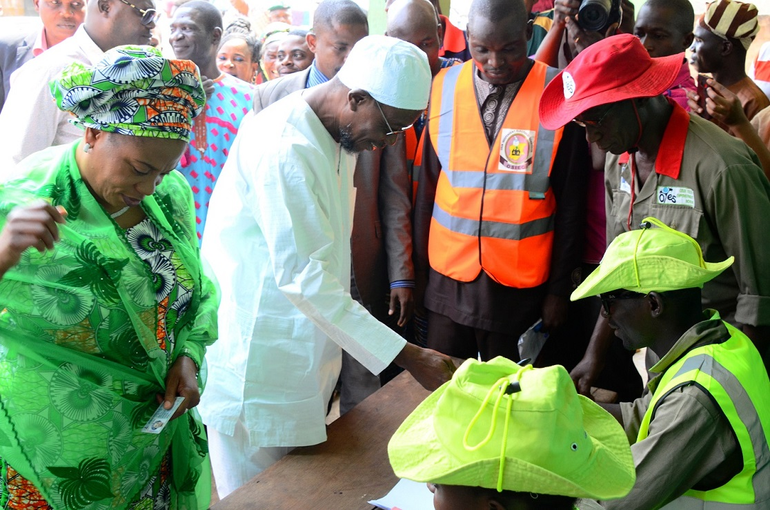 Governor State of Osun, Ogbeni Rauf Aregbesola (2nd left); his wife, Sherifat (left) been accredited by Osun Independent Electoral Commission (OSIEC) officials, during a Referendum Poll for Creation of Additional Local Council Development Area (LCDA) at Unit 1, Ward 8, Ifofin Ilesa, State of Osun on Monday 09-02-2015