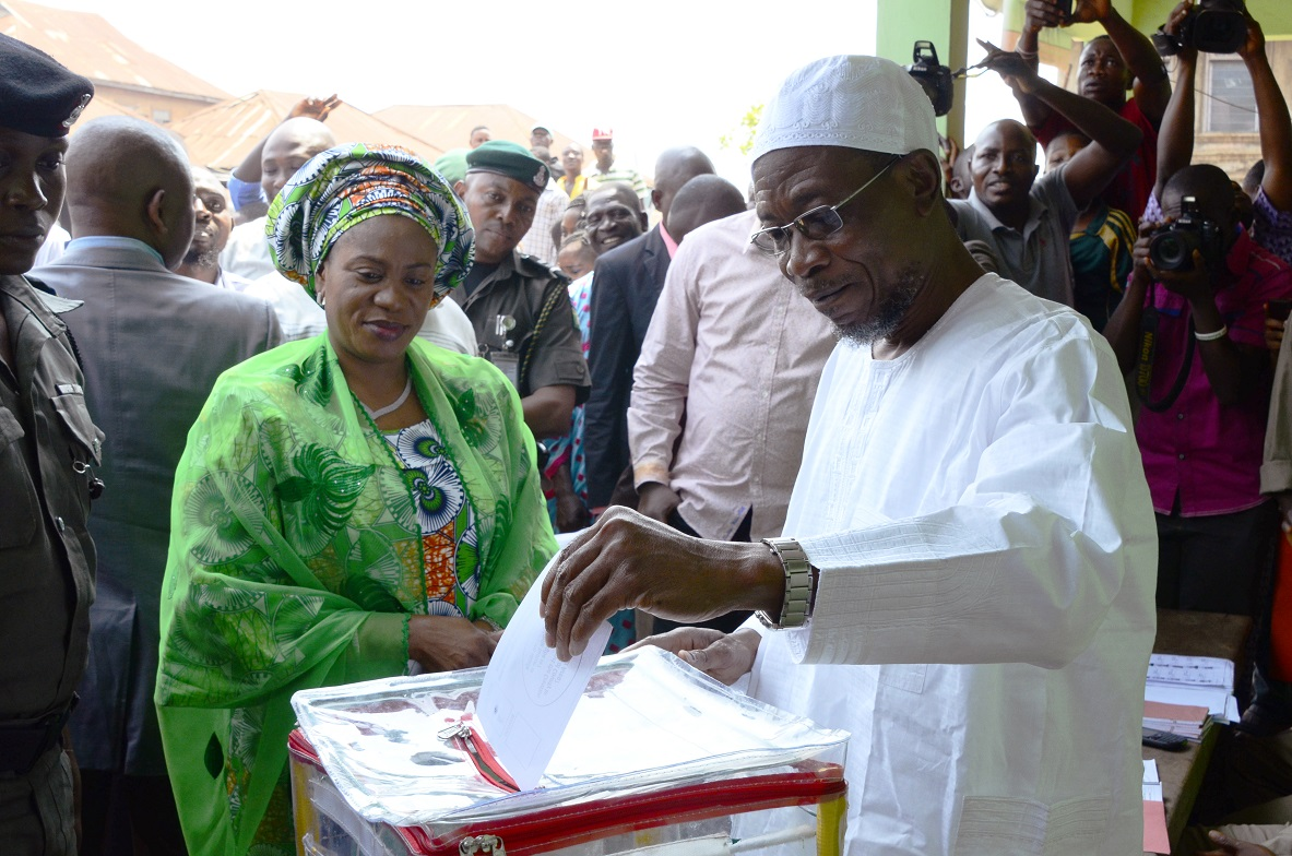 Governor State of Osun, Ogbeni Rauf Aregbesola (right) casting his Vote, during a Referendum Poll for Creation of Additional Local Council Development Area (LCDA) at Unit 1, Ward 8, Ifofin Ilesa, State of Osun. With him is, his wife, Sherifat on Monday 09-02-2015