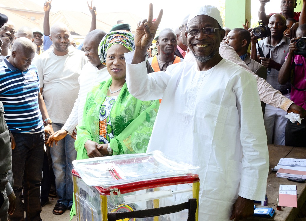 Governor State of Osun, Ogbeni Rauf Aregbesola (right) acknowledging cheers after casting his Vote, during a Referendum Poll for Creation of Additional Local Council Development Area (LCDA) at Unit 1, Ward 8, Ifofin Ilesa, State of Osun. With him are, his wife, Sherifat (2nd right); House Leader, Osun House of Assembly, Honourable Timothy Owoeye (3rd right); Executive Secretary, Ilesa East Local Government, Mr Lanre Balogun (4th right) and others, on Monday 09-02-2015