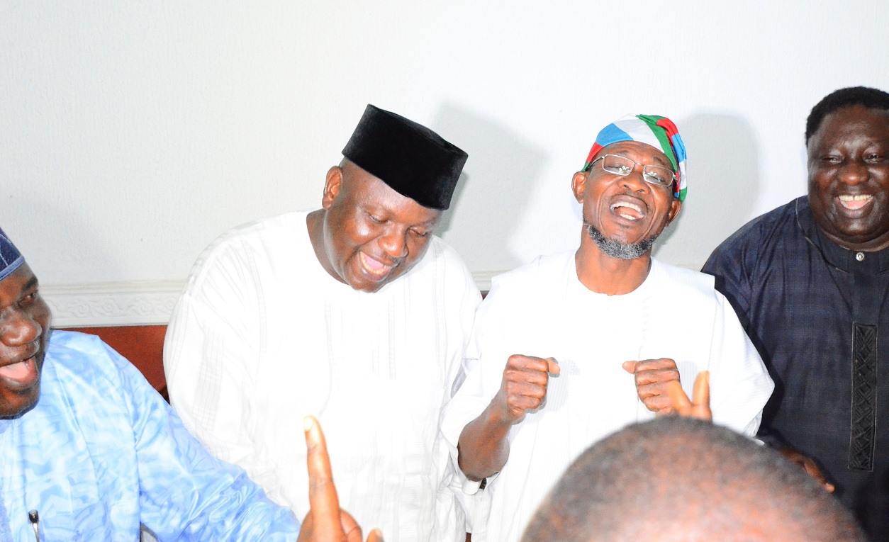 Governor State of Osun, Ogbeni Rauf Aregbesola (2nd right); APC Chairman, Prince Gboyega Famodun (2nd left); Former Lagos State Commissioner, Senator Tokunbo Afikuyomi and others, jubilating after Justice Elizabeth Ikpejime led Tribunal panel dismisses Omisore's petition in Osogbo, State of Osun on Friday 06-02-2015
