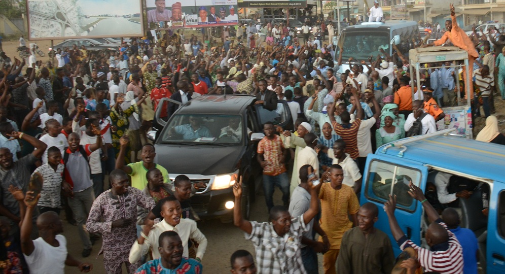 Governor State of Osun, Ogbeni Rauf Aregbesola (atop a bus) acknowledging cheers from the jubilating crowd after been declared winner of the August 9 Governorship election by Justice Elizabeth Ikpejime led Petition Tribunal panel in Osogbo on Friday 06-02-2015
