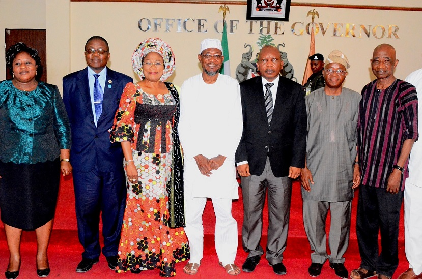 Governor State of Osun, Ogbeni Rauf Aregbesola (centre); his Deputy, Mrs Titi Laoye-Tomori (3rd left); Chief of Staff to the Governor, Mr Gboyega Oyetola (2nd right); Head of Service, Mr Olayinka Owoeye (2nd left); Chairman, Five-man Visitation Panel into the crisis at Osun State University (UNIOSUN), Professor Adebisi Daramola (3rd right); Member of the panel, Professor Omotoye Olorode (right) and Secretary of the Panel, Mrs Olufunke Kolawole (left), during the Panel's Inauguration at the Governor's Office, Osogbo, State of Osun