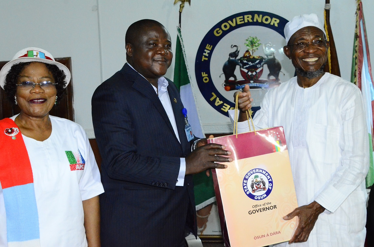 From right- Governor State of Osun, Ogbeni Rauf Aregbesola presenting a gift to the Newly Posted Managing Director of the State Aeronautic Engineering Technical System Limited (AETSL), Air Vice Marshal Ajibola Jekennu while the State Deputy Governor, Mrs. Titi Laoye-Tomori watches during the Familiarization Visit to the Governor at Government House, Oke-Fia, Osogbo