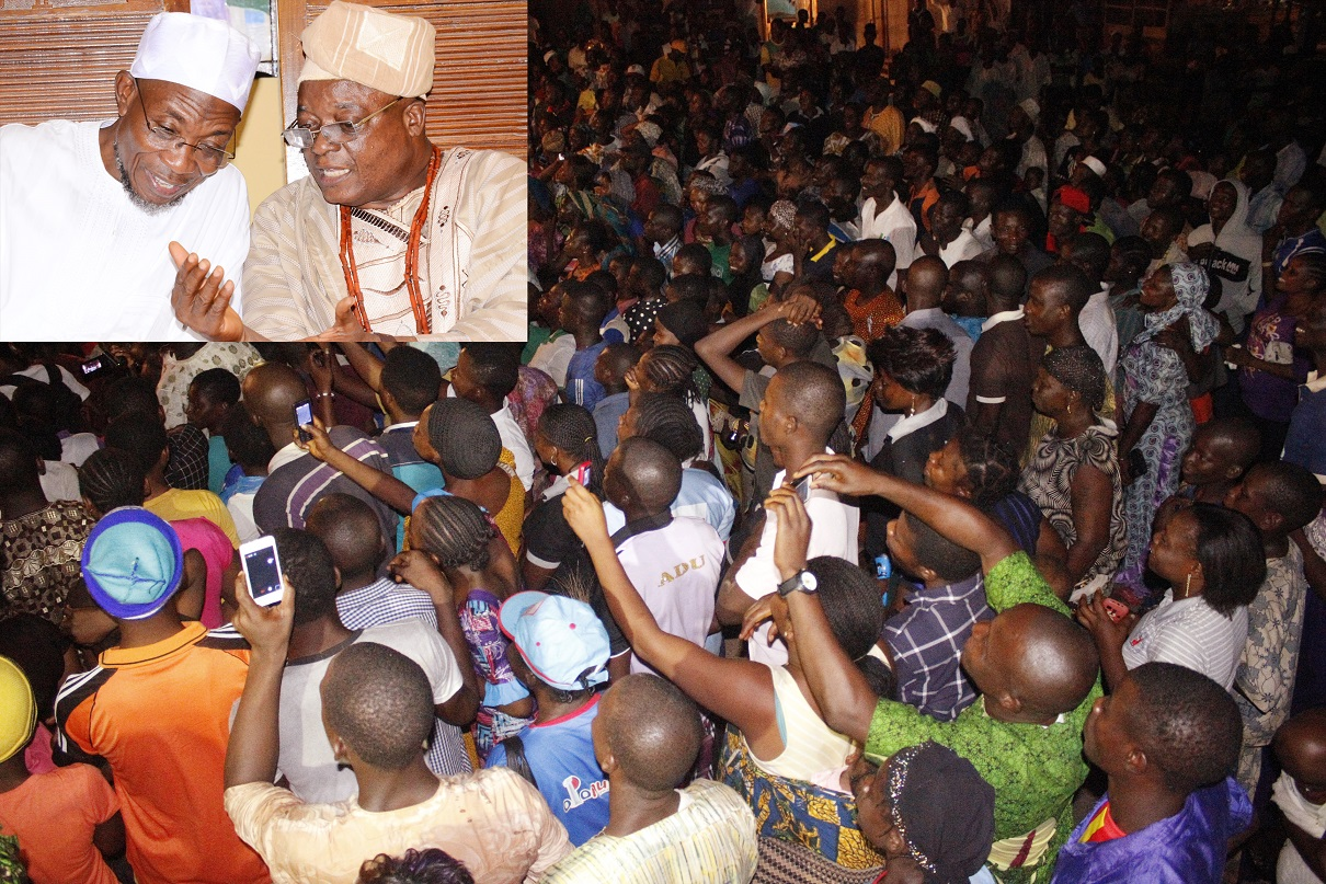 Crowd of crowd, during the All Progressives Congress (APC) Presidential/ National and State House of Assemblies Electioneering Campaigns to Ifewara, Atakunmosa-West Local Government, State of Osun. Insert:Governor State of Osun, Ogbeni Rauf Aregbesola discussing with the Adimula of Ifewara, Oba Hezekiah Adeniyi Owolola