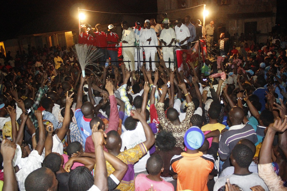Governor State of Osun, Ogbeni Rauf Aregbesola holding microphone with other party Chieftains addressing the enthusiastic supporters of the All Progressives Congress (APC), during the party's Presidential/National and State House of Assemblies Electioneering Campaigns at Osu, Atakunmosa-West Local Government, State of Osun