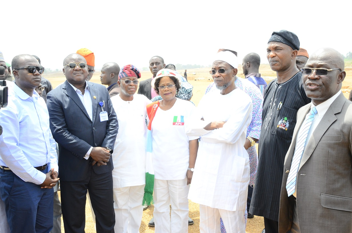 Governor State of Osun, Ogbeni Rauf Aregbesola (3rd right); his Deputy, Mrs. Titi Laoye Tomori (middle); Secretary to the State Government, Alhaji Moshood Adeoti (2nd right); Chief of State to the Governor, Alhaji Gboyega Oyetola (3rd right); the Outgoing Managing Director of the State Aeronautic Engineering Technical System Limited (AETSL), Air Vice Marshal Andy Tsakri (right); the Newly Posted Managing Director of the State Aeronautic Engineering Technical System Limited (AETSL), Air Vice Marshal Ajibola Jekennu (2nd left) and Project Manager of (AETSL), Engineer Aminu Sulaiman (left), during the Inspection Tour to the On-going Construction of Moshood Abiola International Airport, Ido-Osun on Wednesday 04/03/2015