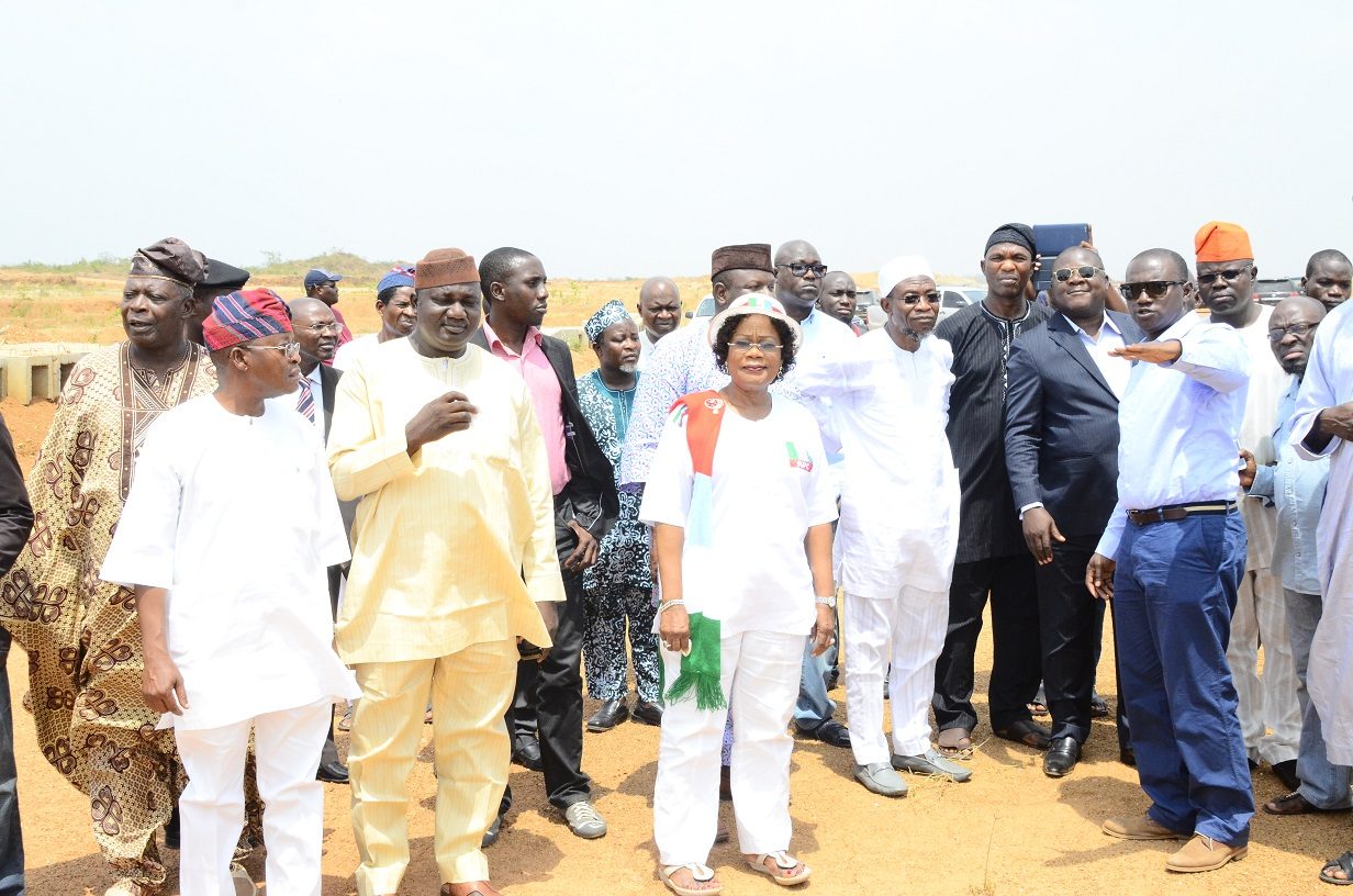 Governor State of Osun, Ogbeni Rauf Aregbesola (4th right); his Deputy, Mrs. Titi Laoye Tomori (3rd left); Secretary to the State Government, Alhaji Moshood Adeoti (3rd right); Chief of State to the Governor, Alhaji Gboyega Oyetola (left); Former State Chairman of the All Progressives Congress (APC), Elder Adelowo Adebiyi (2nd left); the Newly Posted Managing Director of the State Aeronautic Engineering Technical System Limited (AETSL), Air Vice Marshal Ajibola Jekennu (2nd right) and Project Manager of (AETSL), Engineer Aminu Sulaiman (left) during the Inspection Tour to the On-going Construction of Moshood Abiola International Airport, Ido-Osun on Wednesday 04/03/2015.