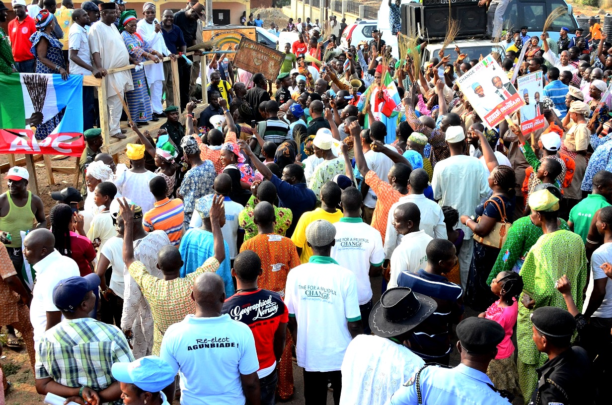 South west Coordinator, Buhari/Osibajo Campaign, Governor Rauf Aregbesola (3rd right); his deputy, Mrs. Titi Laoye-Tomori (middle); Chairman Osun APC, Prince Gboyega Famodun (3rd left)and others addressing supporters, during a Door to Door/Grassroot campaign Rally for Presidential/National and State House of Assemblies, at Ilase-Ijesa, Obokun Local Government Area