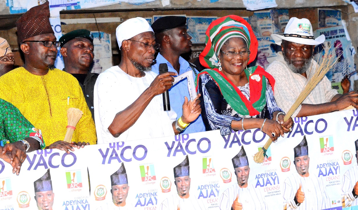 South west coordinator, Buhari/Osibajo Presidential Campaign, Governor Rauf Aregbesola (2nd left); his Deputy, Mrs. Titi Laoye Tomori (2nd right),  APC Osun Central Senatorial Candidate, Sen. Olusola Adeyeye (right) and APC Candidate for Boripe/Ifelodun/Odo-Otin Federal Constituency, Hon. Adeyinka Ajayi [Left] addressing the cheering supporters, during Aregbesola's Grassroot Campaign for Buhari/Osibajo Presidency along National and State House of Assemblies seats, at Eko-Ende, Odo-Otin Local Government Area on Wednesday 18-03-2015