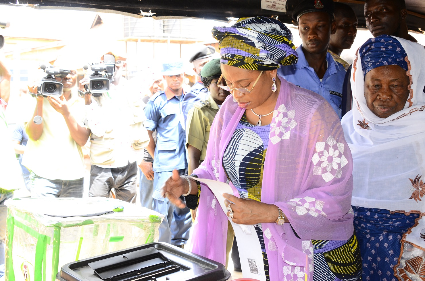 Wife of the Governor, State of Osun, Sherifat  Aregbesola and Aregbesola's Mother, Alhaja Sarat,  casting votes at  Unit 4, Ward 8, Ifofin, Ilesa East Local Government Area, State of Osun, during the Presidential and National Assemblies Elections,on Saturday, 28/03/2015.
