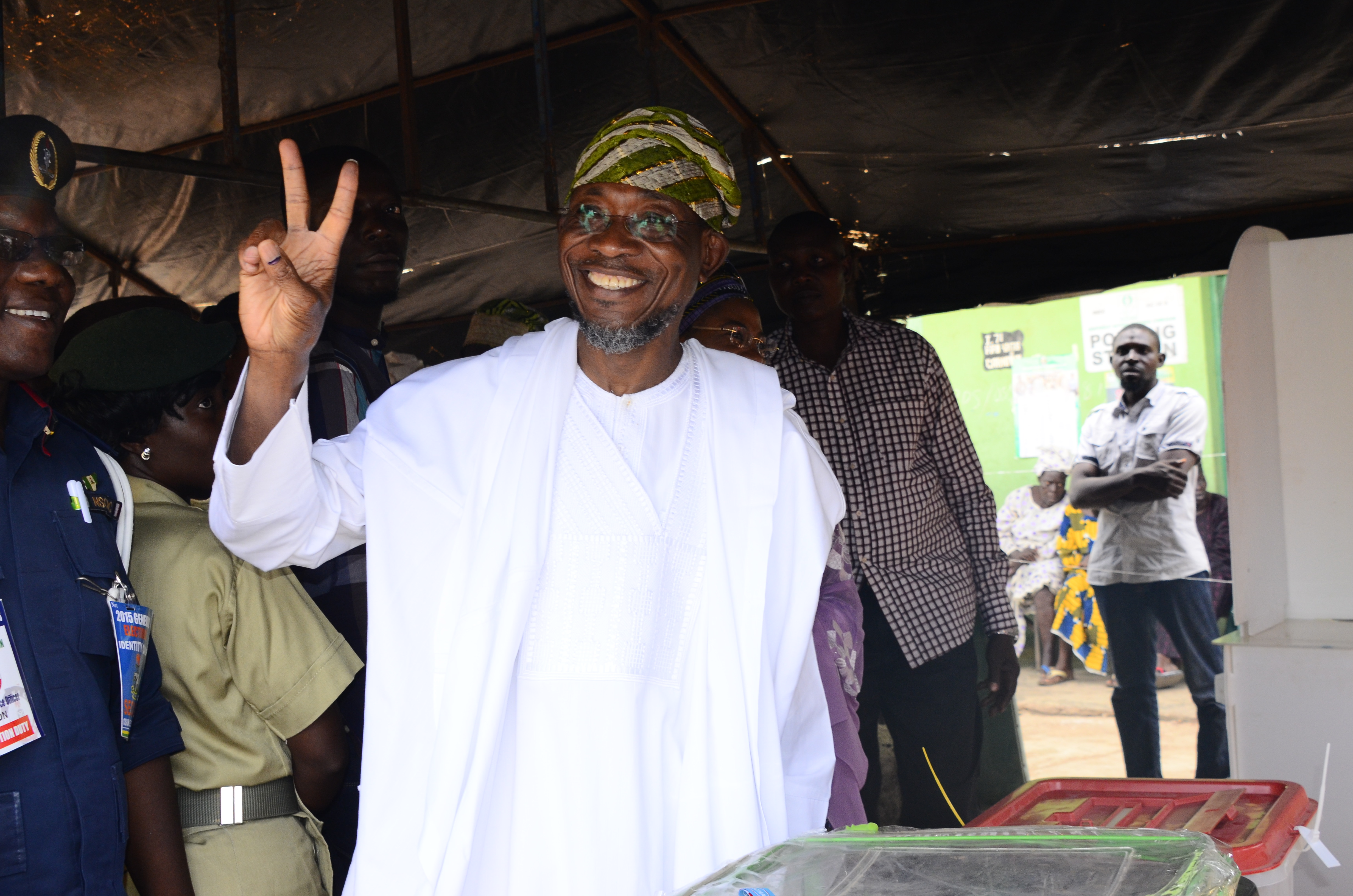 South west Coordinator, Buhari/Osibajo Campaign, Governor Rauf Aregbesola acknowledging cheers from his admirers after casting vote at  Unit 4, Ward 8, Ifofin, Ilesa East Local Government Area, State of Osun, during the Presidential and National Assemblies Elections,on Saturday, 28/03/2015.