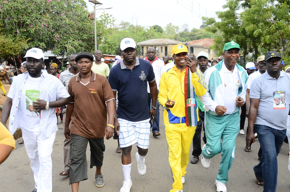 Secretary to the State Government of Osun, Alhaji Moshood Adeoti (2nd right); Former SSG, Alhaji Kazeem Adio (left); Director, Bureau of Communication and Strategy, Mr. Semiu Okanlawon (3rd left); Former Assistant Chief of Staff to Governor Aregbesola, Hon. Mudathir Toogun (3rd right); Member, House of Assembly, Hon. Ezekiel Adedibu (2nd left); APC Chairman, Iwo Local Government, Hon. Semiu Ayofe (right) and others, during a Walk-For-Continuity Exercise in support of APC Candidates in the House of Assembly in Iwo on Thursday 09-04-2015