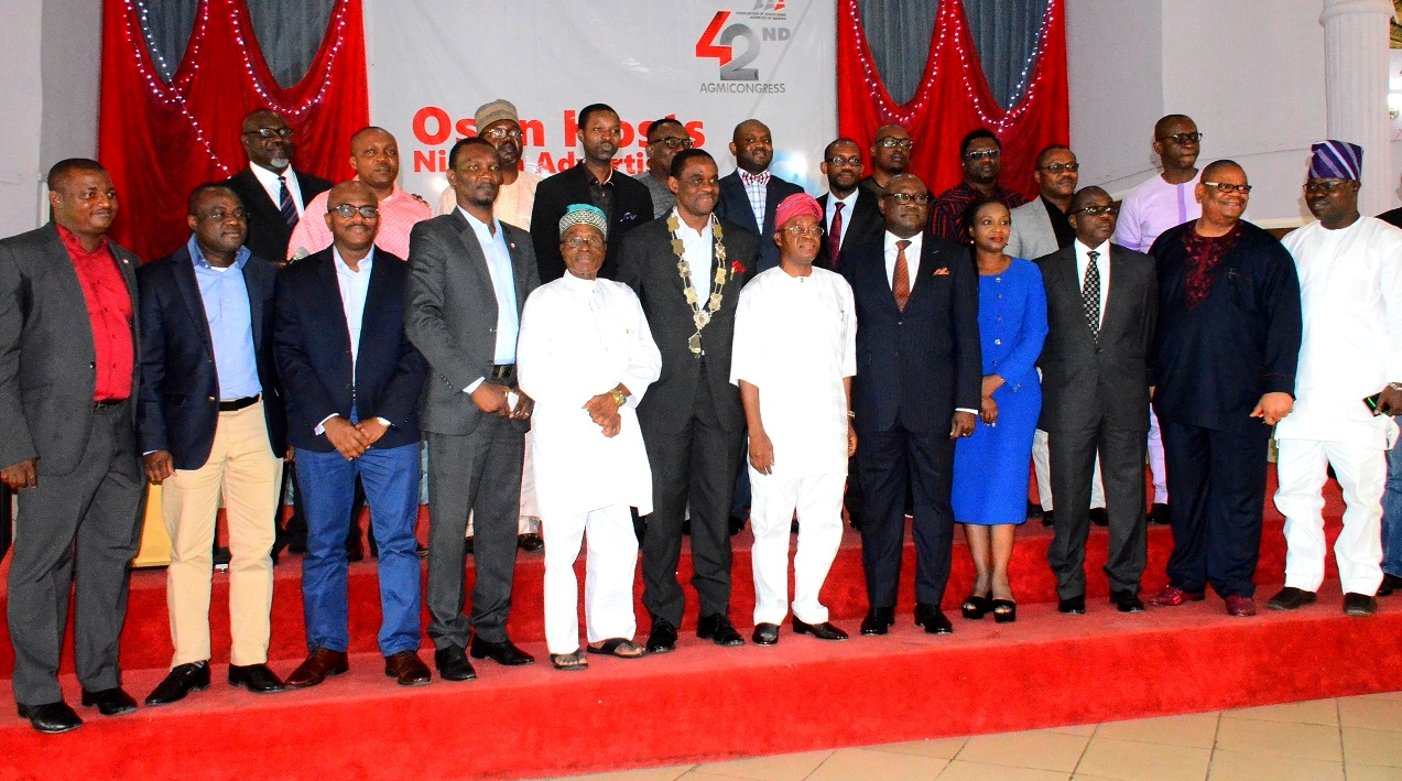 Representative of Osun Governor and Chief of Staff to the Governor, Alhaji Gboyega Oyetola(6th right);President, Association of Advertising Agencies of Nigeria, Mr. Kelechi Nwosu(6th left); Chairman, Advertising Practitioners Council of Nigeria (APCON), Mr. Udeme Utot (5th right),Chairman Board of Trustees (AAAN), Mr. Ayo Owoborode(5th left), Vice Chairman Event Planning Committee (AAAN),Mrs. Bisi Afolabi (4th right) Chairman Event Planning Committee (AAAN), Mr. Tunji Olugbodi (2nd right), Director of Bureau of Communition and Strategy, Office of Osun Governor, Mr. Semiu Okanlawon and others, during the 42nd Annual General Meeting and Congress of the Association of Advertising Agencies of Nigeria, at Leisure Spring Hotel, Osogbo, on Friday 24/07/2015.