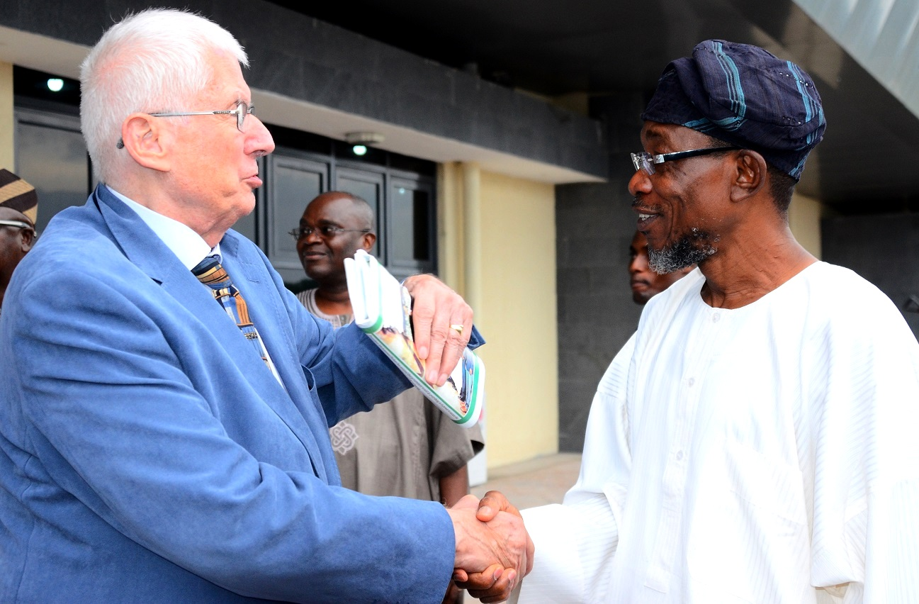 Governor State of Osun, Ogbeni Rauf Aregbesola (right) exchanging pleasantries with Executive Chairman, Safari Books Limited, Chief Joop Berkhout, at Ibadan Airport on Tuesday 14/07/2015.