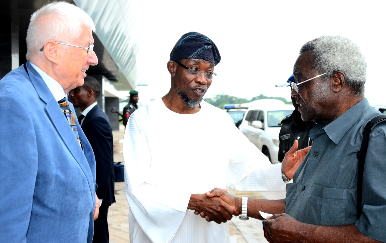Governor State of Osun, Ogbeni Rauf Aregbesola (middle);  Executive Chairman, Safari Books Limited, Chief Joop Berkhout (left) and Professor Johnson Ekpere (right), at Ibadan Airport on Tuesday 14/07/2015.