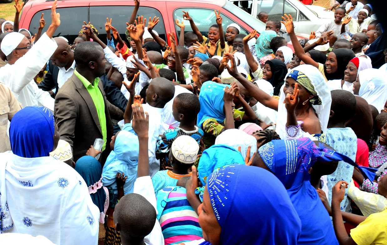 Governor State of Osun, Ogbeni Rauf Aregbesola on the top of vehicle acknowledging cheers from the Muslim faithful, during the Post-Ramadan Prayers/Lecture organized by the Nasrul-Lahi-L-Fatih Society (NASFAT), Osogbo Branch, on Sunday 19/07/2015.