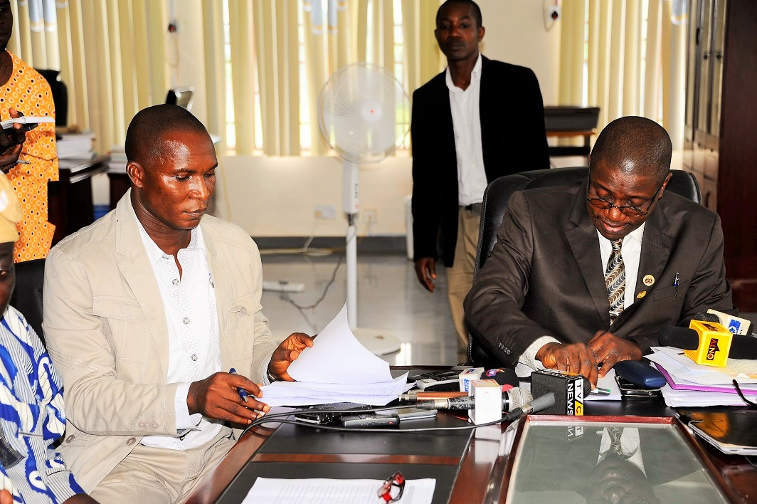 Head of service State of Osun, Mr Sunday Owoeye(right); Chairman Nigerian Labour Congress (NLC), Comrade Jacob Adekomi (left), during the Signing of Memorandum of Understanding Between the Labour Unions and State Government to end  seven week strike, at Government Secretariat, Abere on Monday 13-7-2015.