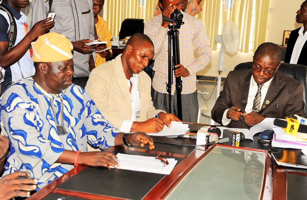 Head of Service State of Osun, Mr Sunday Owoeye (right); Chairman Nigeria Labour Congress (NLC), Comrade Jacob Adekomi (2nd left); State Chairman Joint Public Service Negotiating Council, Mr Bayo Adejumo (left), during the Signing of Memorandum of Understanding Between the Labour Unions and Government to end  seven week strike, at Government Secretariat, Abere on Monday 13-7-2015.