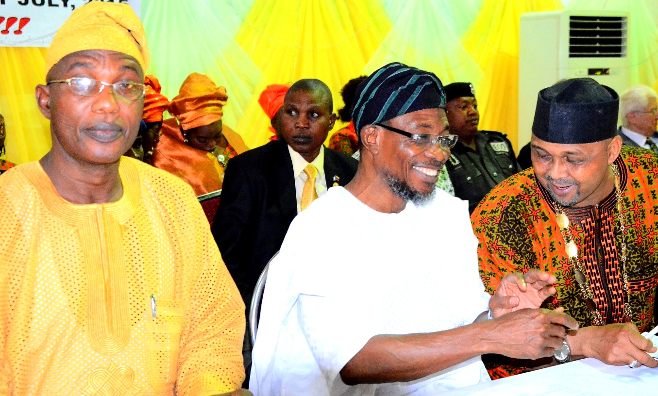 """Governor State of Osun, Ogbeni Rauf Aregbesola(middle); President, Nigerian Library Association, Alhaji Ridwan Abdul-Salami(right) and Secretary to Osun State Government, Alhaji Moshood Adeoti(left) during the 53rd Annual General Meeting/National Conference of Nigerian Library Association NLA tagged """"Omoluabi 2015"""", at WOCDIF Event Centre, Osogbo, on Tuesday 28/07/2015."""