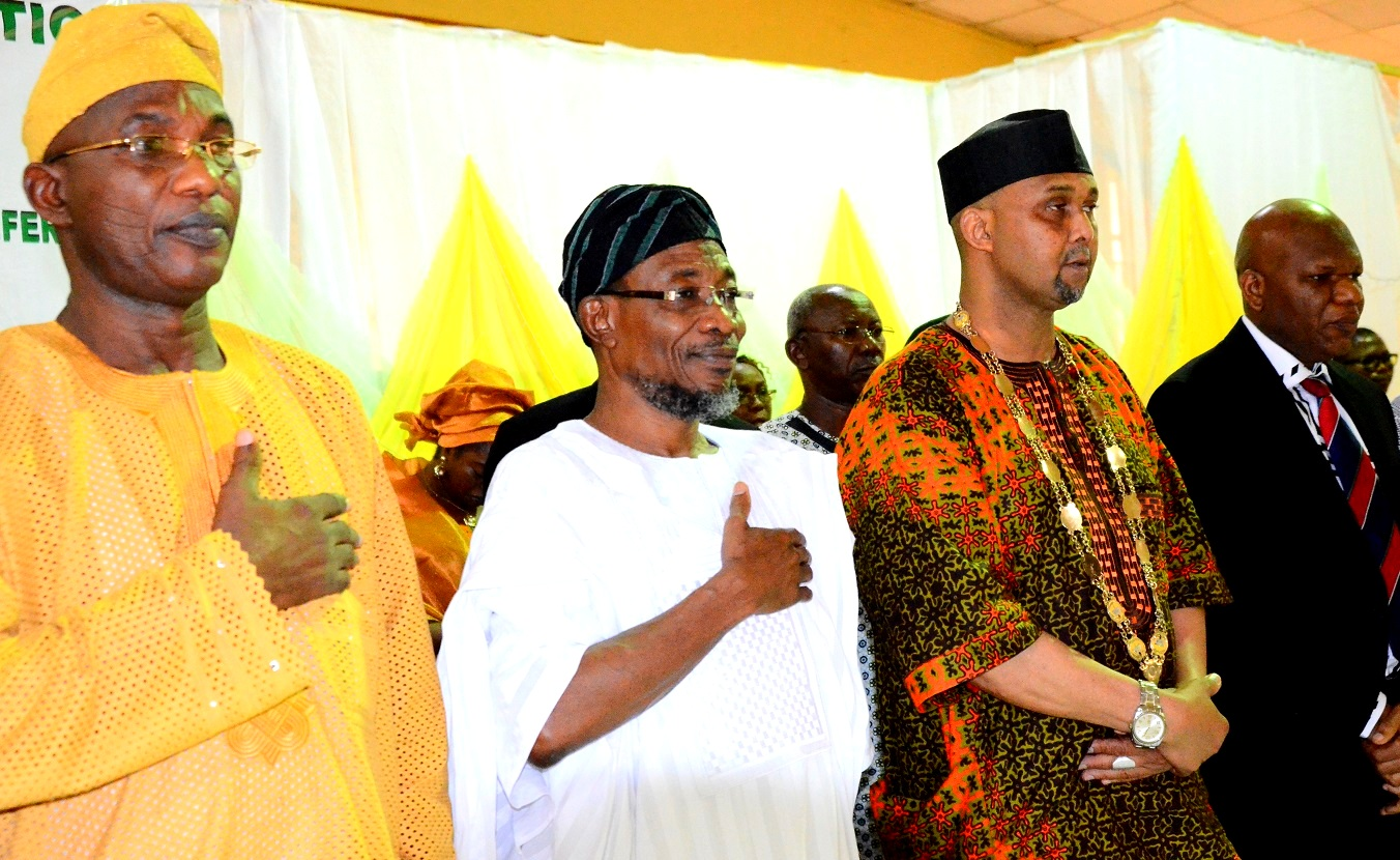 """Governor State of Osun, Ogbeni Rauf Aregbesola(2nd left); President, Nigerian Library Association, Alhaji Ridwan Abdul-Salami(2nd right), Secretary to the State Government, Alhaji Moshood Adeoti(left) and Chairman of the Occasion, Prof. Eyitope Ogunbodede during the 53rd Annual General Meeting/National Conference of Nigerian Library Association NLA tagged """"Omoluabi 2015"""", at WOCDIF Event Centre, Osogbo, on Tuesday 28/07/2015."""
