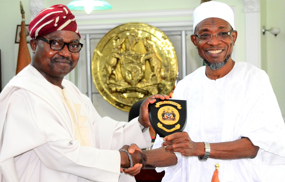 Governor State of Osun, Ogbeni Rauf Aregbesola (right) presenting the State Emblem to the President, North America Based of Egbe Omo Yoruba, Agba-Akin Bolu Omodele, during the Delegation's visit to the Governor in his Office, at Government Secretariat, Abere, Osogbo, on Tuesday 07/07/2015.
